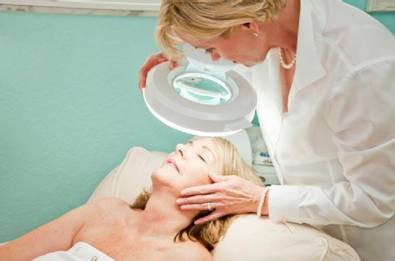 doctor examining skin